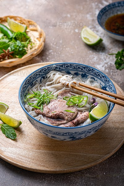 Rice noodles soup with beef and herbs, vietnamese cuisine