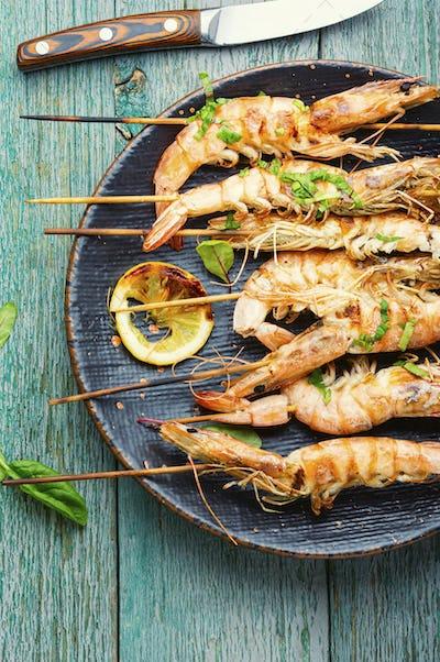 Langoustines or prawns on a skewer