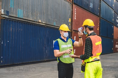 Staff are checking fever for logistic workers, engineers and foreman, In the container storage