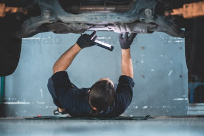 mechanic car service working in garage, workshop to check and maintenance repair automobile