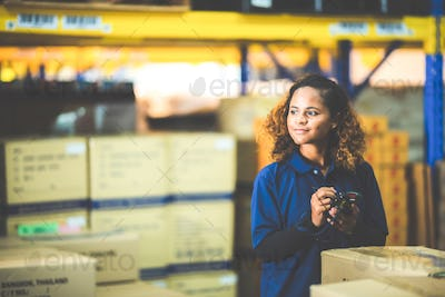 A close up portrait of women who working in the warehouse storehouse, empower women, foreman