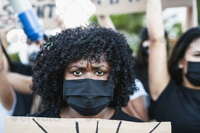 Young Afro woman activist protesting against racism and fighting for equality