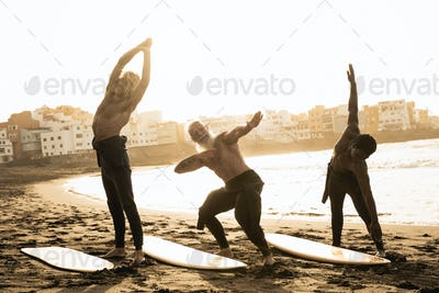 Surfers warming up before surf session at the beach during summer vacation