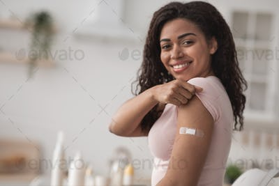 Female get covid-19 immunization at home. Health care and medical procedure