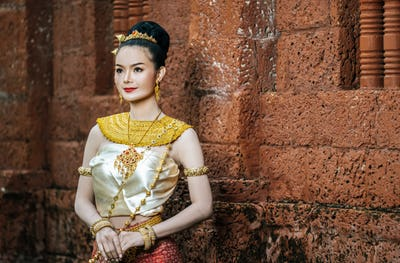 Charming Thai woman in Beautiful traditional dress at archaeological site