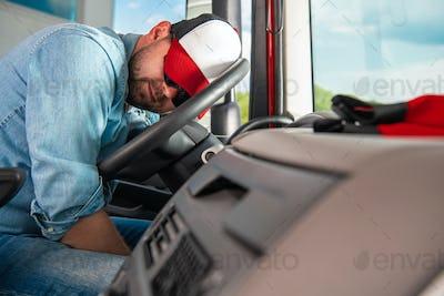 Semi Truck Driver Sleeping on the Steering Wheel