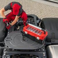 Professional Truck Mechanic Performing Vehicle Maintenance