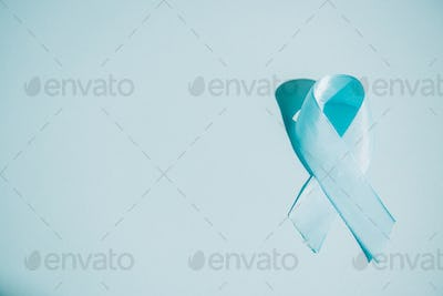 blue awareness ribbon on white background with copy space