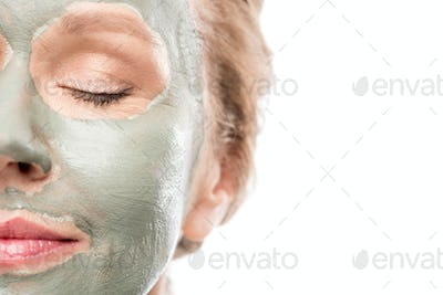 cropped view of mature woman with clay mask Isolated On White