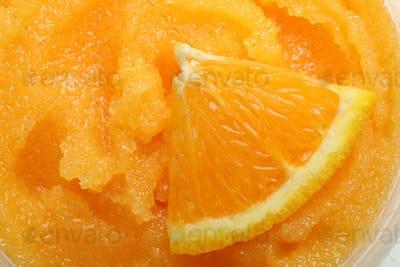 Skin care cosmetic orange scrub, close up