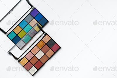 Make up colorful eyeshadow palettes isolated on white