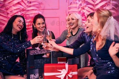 High-spirited female friends having a bachelorette party