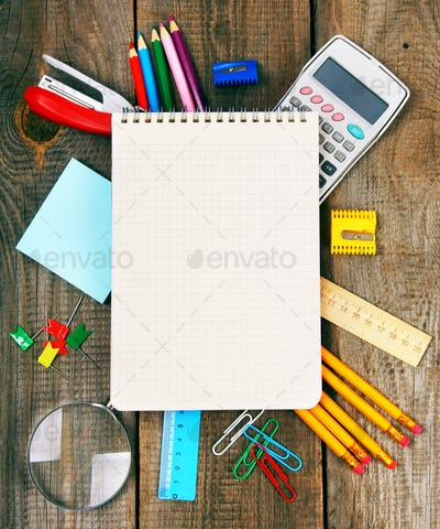 Notebook and school tools around.