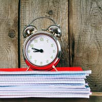 Writing-books and an alarm clock .