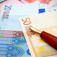 Pen and money (euro).