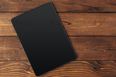 digital tablet on wooden table creative photo