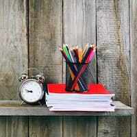 Alarm clock and school accessories .