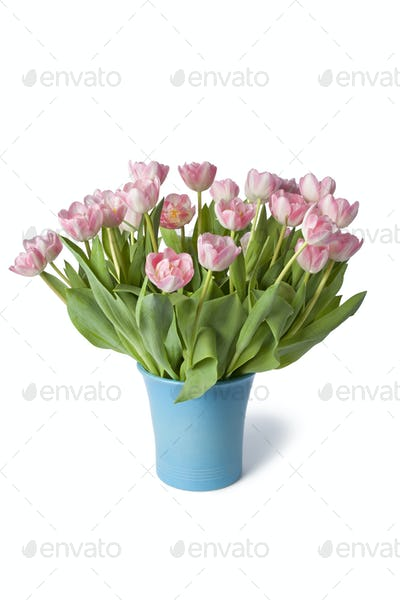 Blue vase with pink tulipes