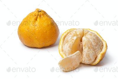 Whole and partial peeled ugli fruit
