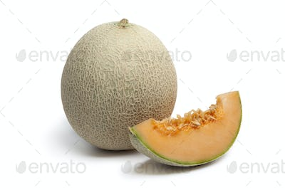 Whole Cantaloupe melon with a slice