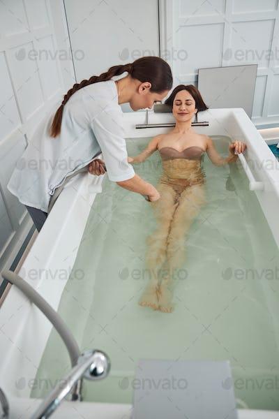 Resting female enjoying water massage of her hips