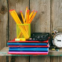 Writing-books, an alarm clock and school tools .