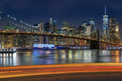 Automotive and parking lot concept, road of parking over New York cityscape and brooklyn bridge