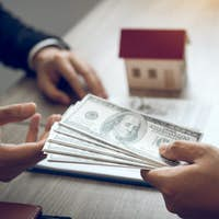 Investors are using st pen on the contract paper about buying a new home while filing cash