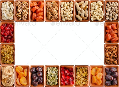food frame of dehydrated fruits, seeds and nuts on white
