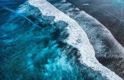 Coast as a background from top view. Turquoise water background from top view. Summer seascape