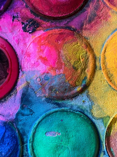 Colorful Watercolor paint palette set in circles dirty