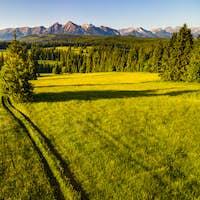 Rural Countrtysidde Road in Lapszanka Pasture Meadows. Picturesque High Tatras in Spis, Poland