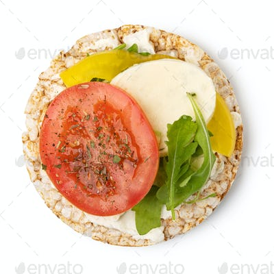 Rice cakes with cheese and tomato
