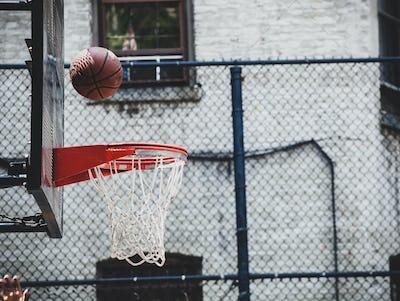 Basketball hoop in a neighborhood playing field in New York.
