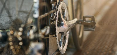 Website header of Detailed view of bicycle mechanisms. Sprocket, pedal and chain on a mountain bike