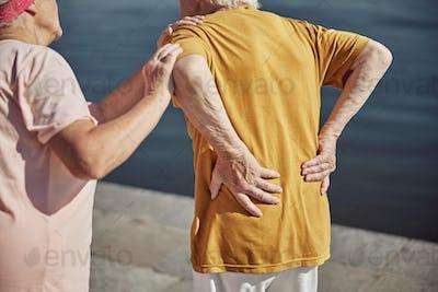 Caucasian male pensioner experiencing an acute backache