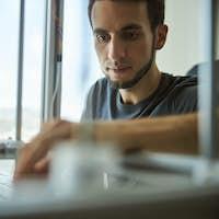 Focused male scientist using a 3D printer