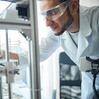 Serious man examining the 3D printed denture
