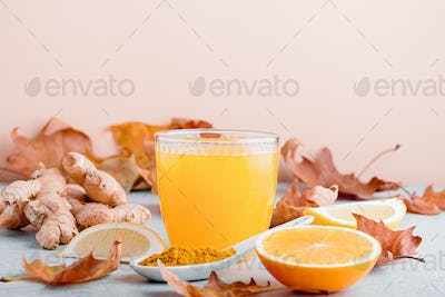 Immune boosting drink with citrus fruits, ginger, turmeric