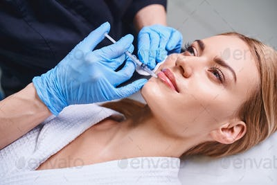 Smiling lady during rejunivation treatment stock photo