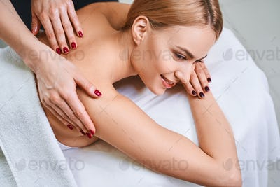Smiling pretty woman during massage stock photo
