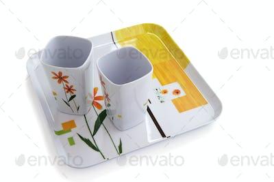 Empty mugs on serving tray