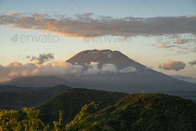 Mountain valley with dormant volcano on background