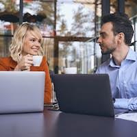 Two business people taking a coffee break