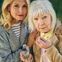 Portrait of two beautiful mature women posing to the camera