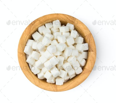 Sugar cube in wood bowl isolated on white background