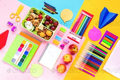 Back to school flat lay with supplies and lunchbox