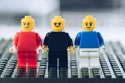 KYIV, UKRAINE - MARCH 15, 2019: red, blue and black lego minifigures with various face expressions