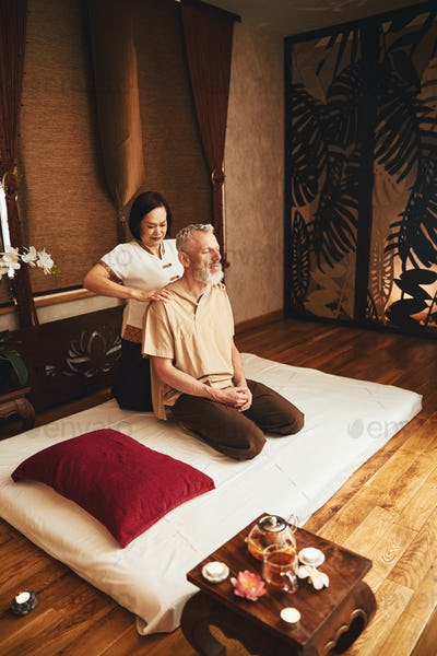 Grizzled calm male visiting oriental massage centre