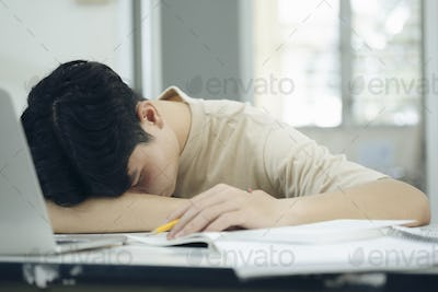 Tried young male student fell asleep
